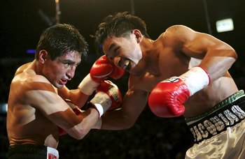 LAS VEGAS - NOVEMBER 18:  (R-L) Manny Pacquiao of the Philippines and Erik Morales of Mexico exchange blows during their super featherweight bout at the Thomas & Mack Center on November 18, 2006 in Las Vegas, Nevada. Pacquiao won after a third round knock