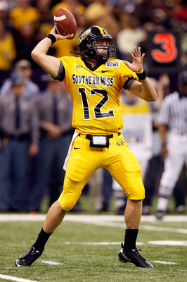 NEW ORLEANS - DECEMBER 21:  Quarterback Austin Davis #12 of the Southern Mississippi Golden Eagles looks to throw a pass against the Troy Trojans during the R+L Carriers New Orleans Bowl on December 21, 2008 at the Superdome in New Orleans, Louisiana.  (P