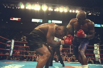 9 Nov 1996:  Mike Tyson ducks to cover his head from the punches of  Evander Holyfield before losing by TKO in the 11th round at the MGM Grand Garden in Las Vegas, Nevada. Mandatory Credit: Al Bello  /Allsport