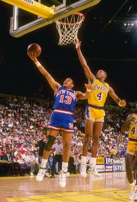 1989-1990:  Guard Mark Jackson of the New York Knicks goes up for two as guard Byron Scott of the Los Angeles Lakers tries to block during a game at the Great Western Forum in Inglewood, California. Mandatory Credit: Mike Powell  /Allsport