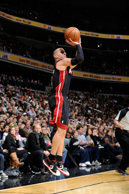 WASHINGTON, DC - DECEMBER 18:  Carlos Arroyo #8 of the Miami Heat shoots a jump shot against the Washington Wizards at the Verizon Center on December 18, 2010 in Washington, DC. NOTE TO USER: User expressly acknowledges and agrees that, by downloading and