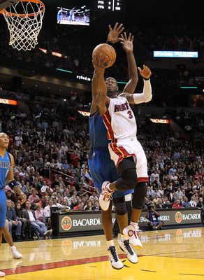 MIAMI, FL - DECEMBER 20:  Dwyane Wade #3 of the Miami Heat shoots over Shawn Marion #0 of the Dallas Mavericks during a game at American Airlines Arena on December 20, 2010 in Miami, Florida. NOTE TO USER: User expressly acknowledges and agrees that, by d