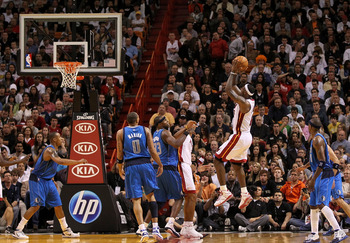 MIAMI, FL - DECEMBER 20:  LeBron James #6 of the Miami Heat shoots a jumpshot during a game against the Dallas Mavericks at American Airlines Arena on December 20, 2010 in Miami, Florida. NOTE TO USER: User expressly acknowledges and agrees that, by downl