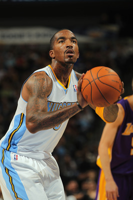 DENVER - NOVEMBER 11:  J.R. Smith #5 of the Denver Nuggets takes a free throw against the Los Angeles Lakers at the Pepsi Center on November 11, 2010 in Denver, Colorado. The Nuggets defeated the Lakers 118-112.  NOTE TO USER: User expressly acknowledges