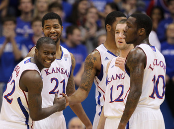 LAWRENCE, KS - DECEMBER 18:  Josh Selby #32 of the Kansas Jayhawks jokes with teammates prior to the start of the game against the USC Trojans on December 18, 2010 at Allen Fieldhouse in Lawrence, Kansas.  (Photo by Jamie Squire/Getty Images)