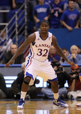 LAWRENCE, KS - DECEMBER 18:  Josh Selby #32 of the Kansas Jayhawks in action during the game against the USC Trojans on December 18, 2010 at Allen Fieldhouse in Lawrence, Kansas.  (Photo by Jamie Squire/Getty Images)
