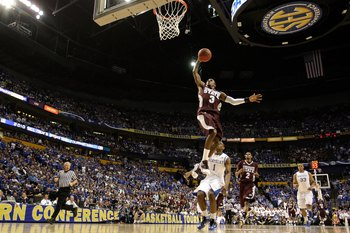 NASHVILLE, TN - MARCH 14:  Dee Bost #3 of the Mississippi State Bulldogs dunks against the Kentucky Wildcats during the final of the SEC Men's Basketball Tournament at the Bridgestone Arena on March 14, 2010 in Nashville, Tennessee. Kentucky won 75-74 in