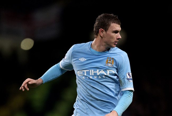 MANCHESTER, ENGLAND - JANUARY 15:  Edin Dzeko of Manchester City in action during the Barclays Premier League match between Manchester City and Wolverhampton Wanderers at the City of Manchester Stadium on January 15, 2011 in Manchester, England.  (Photo b