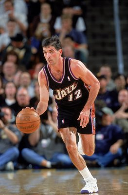 3 May 2000:  John Stockton #12 of the Utah Jazz dribbles the ball down the court during the NBA Western Conference Playoffs Round One Game against the Seattle SuperSonics at Key Arena in Seattle, Washington. The SuperSonics defeated the Jazz 104-93  NOTE