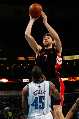 NEW ORLEANS - FEBRUARY 06:  Andrea Bargnani #7 of the Toronto Raptors makes a shot over Rasual Butler #45 of the New Orleans Hornets on February 6, 2009 in New Orleans, Louisiana. The Hornets defeated the Raptors 101-92.   NOTE TO USER: User expressly ack