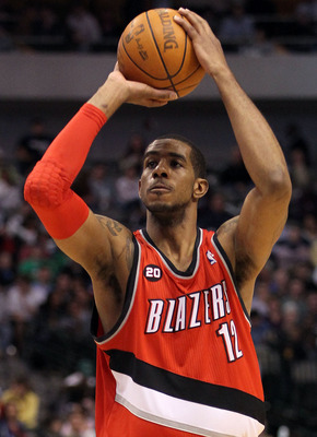 DALLAS, TX - DECEMBER 15:  LaMarcus Aldridge #12 of the Portland Trail Blazers at American Airlines Center on December 15, 2010 in Dallas, Texas. NOTE TO USER: User expressly acknowledges and agrees that, by downloading and or using this photograph, User