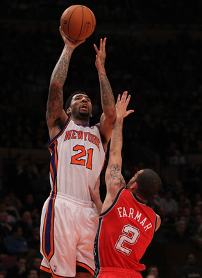NEW YORK, NY - NOVEMBER 30:  Wilson Chandler #21 of the New York Knicks shoots the ball over Jordan Farmer #2 of the New Jersey Nets on November 30, 2010 at Madison Square Garden in New York City. NOTE TO USER: User expressly acknowledges and agrees that,