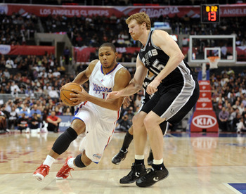 LOS ANGELES, CA - DECEMBER 01:  Eric Gordon #10 of the Los Angeles Clippers drives around Matt Bonner #15 of the San Antonio Spurs during the game at the Staples Center on December 1, 2010 in Los Angeles, California.  NOTE TO USER: User expressly acknowle