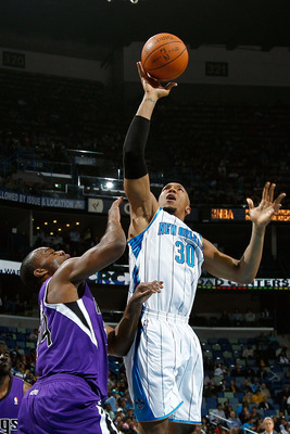 NEW ORLEANS, LA - DECEMBER 15:  David West #30 of the New Orleans Hornets shoots the ball over Carl Landry #24 of the Sacramento Kings at the New Orleans Arena on December 15, 2010 in New Orleans, Louisiana.  NOTE TO USER: User expressly acknowledges and