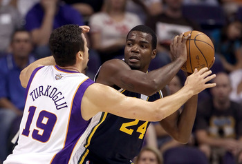 PHOENIX - OCTOBER 12:  Paul Millsap #24 of the Utah Jazz looks to pass the ball during the preseason NBA game against the Phoenix Suns at US Airways Center on October 12, 2010 in Phoenix, Arizona. NOTE TO USER: User expressly acknowledges and agrees that,