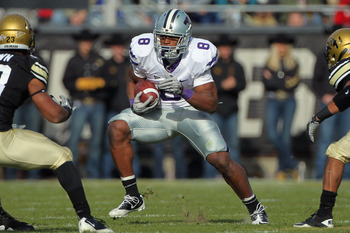 BOULDER, CO - NOVEMBER 20:  Daniel Thomas #8 of the Kansas State Wildcats rushes with the ball against the Colorado Buffaloes at Folsom Field on November 20, 2010 in Boulder, Colorado. Colorado defeated Kansas State 44-36.  (Photo by Doug Pensinger/Getty