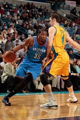 NEW ORLEANS, LA - DECEMBER 10:  Kevin Durant #35 of the Oklahoma City Thunder drives the ball around Jason Smith #14 of the New Orleans Hornets  at New Orleans Arena on December 10, 2010 in New Orleans, Louisiana.    The Thunder defeated the Hornets 97-92