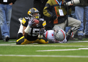 IOWA CITY, IA - NOVEMBER 20: Wide receiver Derrell Johnson-Koulianos #15 pulls in a pass as defensive back Chimdi Chekwa #5 of the Ohio State Buckeyes defends during the first half of play at Kinnick Stadium on November 20, 2010 in Iowa City, Iowa. Ohio w