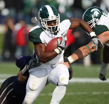 EVANSTON, IL - OCTOBER 23: Edwin Baker #4 of the Michigan State Spartans breaks away from Brian Peters #10 of the Northwestern Wildcats at Ryan Field on October 23, 2010 in Evanston, Illinois. Michigan State defeated Northwestern 35-27.  (Photo by Jonatha