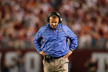 TUSCALOOSA, AL - OCTOBER 02:  Head coach Urban Meyer of the Florida Gators looks down at the ground on the sidelines during their game against the Alabama Crimson Tide at Bryant-Denny Stadium on October 2, 2010 in Tuscaloosa, Alabama.  (Photo by Kevin C.