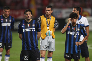 MONACO - AUGUST 27: Diego Milito (centre L) and Coutinho (R) and Inter Milan team-mates stand dejected after their team's 0-2 defeat at the end of the UEFA Super Cup match between Inter Milan and Atletico Madrid at Louis II Stadium on August 27, 2010 in M