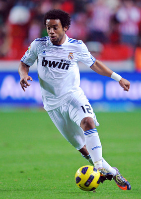 GIJON, SPAIN - NOVEMBER 14:  Marcelo of Real Madrid in action during the La Liga match between Sporting Gijon and Real Madrid at El Molinon Stadium on November 14, 2010 in Gijon, Spain.  (Photo by Denis Doyle/Getty Images)