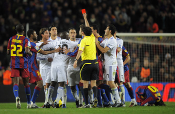BARCELONA, SPAIN - NOVEMBER 29:  Sergio Ramos (3thL) is shown the red card by referee Iturralde Gonzalez during the La Liga match between Barcelona and Real Madrid at the Camp Nou Stadium on November 29, 2010 in Barcelona, Spain.  Barcelona won the match
