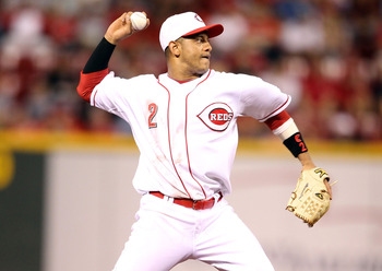CINCINNATI - SEPTEMBER 11:  Orlando Cabrera #2 of the Cincinnati Reds throws to first base during the game against the Pittsburg Pirates at Great American Ball Park on September 11, 2010 in Cincinnati, Ohio.  (Photo by Andy Lyons/Getty Images)