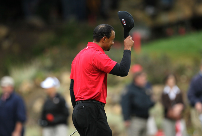 THOUSAND OAKS, CA - DECEMBER 05:   Tiger Woods tips his cap on the 18th green after he finished regulation in a tie with  Graeme McDowell of Northern Ireland during the final round of the Chevron World Challenge at Sherwood Country Club on December 5, 201