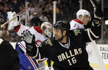 DALLAS, TX - DECEMBER 21:  Right wing Adam Burish #16 of the Dallas Stars celebrates a short handed goal against the Montreal Canadiens at American Airlines Center on December 21, 2010 in Dallas, Texas.  (Photo by Ronald Martinez/Getty Images)