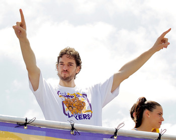 LOS ANGELES, CA - JUNE 21:  Los Angeles Lakers forward Pau Gasol salutes the crowd while riding in the victory parade for the the NBA basketball champion team on June 21, 2010 in Los Angeles, California. The Lakers beat the Boston Celtics 87-79 in 7 games