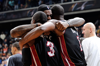 WASHINGTON, DC - DECEMBER 18:  LeBron James #6 of the Miami Heat celebrates with Dwyane Wade #3 and Chris Bosh #1 after a 95-94 victory over the Washington Wizards at the Verizon Center on December 18, 2010 in Washington, DC. NOTE TO USER: User expressly