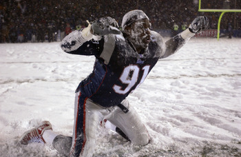 19 Jan 2002:  Bobby Hamilton #91 of the New England Patriots celebrates in the snow after a overtime win in the AFC playoff game against the Oakland Raiders at Foxboro Stadium in Foxboro, Massachuesetts. The Patriots came from behind to win 16-13 in overt