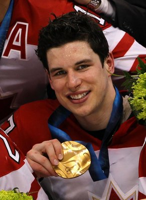 VANCOUVER, BC - FEBRUARY 28:  Sidney Crosby #87 of Canada poses for a photo after the ice hockey men's gold medal game between USA and Canada on day 17 of the Vancouver 2010 Winter Olympics at Canada Hockey Place on February 28, 2010 in Vancouver, Canada.