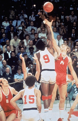 MUNICH, GERMANY - SEPTEMBER 10:  USA Basketball team battles for the tip off against the Russia basketball team on September 10, 1972 in Munich, Germany. The Russia won this controversial game 51 to 50 after being given extra time to get a final shot off.