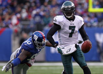 EAST RUTHERFORD, NJ - DECEMBER 19:  Michael Vick #7 of the Philadelphia Eagles rushes past the tackle attempt of Jason Pierre-Paul #90 of the New York Giants at New Meadowlands Stadium on December 19, 2010 in East Rutherford, New Jersey.  (Photo by Nick L