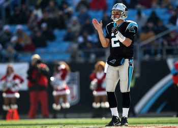 CHARLOTTE, NC - DECEMBER 19:  Jimmy Clausen #2 of the Carolina Panthers cheers on his team during their game against the Arizona Cardinals at Bank of America Stadium on December 19, 2010 in Charlotte, North Carolina.  (Photo by Streeter Lecka/Getty Images