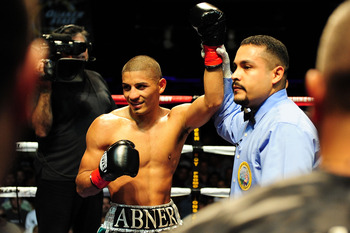 LOS ANGELES - AUGUST 27:  Abner Mares celebrates his victory against opponent Carlos Fulgencio on August 27, 2009 in Los Angeles, California.  (Photo by Jacob de Golish/Getty Images)