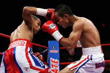NEW YORK - JUNE 13:  Ivan Calderon punches Rodel Mayol during their WBO Mini Flyweight title fight at Madison Square Garden on June 13, 2009 in New York City.   (Photo by Al Bello/Getty Images)