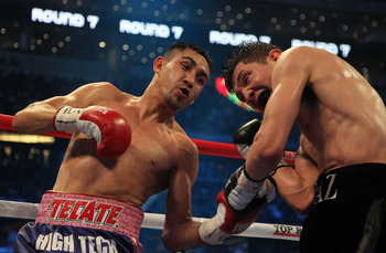 ARLINGTON, TX - MARCH 13:  (L-R) Humberto Soto of Mexico connects with a left to David Diaz in round seven during the WBC lightweight title fight at Cowboys Stadium on March 13, 2010 in Arlington, Texas. Soto defeated Diaz by decision. (Photo by Jed Jacob