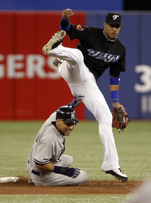 TORONTO, ON - SEPTEMBER 28: Yunel Escobar #5 of the Toronto Blue Jays makes the double play on Derek Jeter #2 of the New York Yankees during an MLB game at the Rogers Centre September 28, 2010 in Toronto, Ontario, Canada. (Photo by Abelimages/Getty Images
