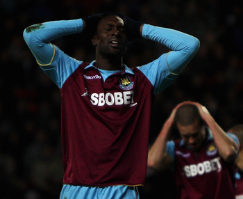 BLACKBURN, ENGLAND - DECEMBER 18:  Carlton Cole of West Ham holds his head after a missed chance during the Barclays Premier League match between Blackburn Rovers and West Ham United at Ewood park on December 18, 2010 in Blackburn, England.  (Photo by Dea