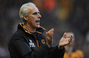 WOLVERHAMPTON, ENGLAND - NOVEMBER 13:  Wolves manager Mick McCarthy reacts during the Barclays Premier League match between Wolverhampton Wanderers and Bolton Wanderers at Molineux on November 13, 2010 in Wolverhampton, England.  (Photo by Michael Regan/G