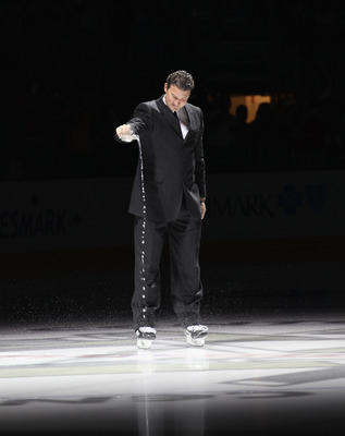 PITTSBURGH - OCTOBER 07:  Team owner Mario Lemieux of the Pittsburgh Penguins accompanied with water from the Mellon Arena salutes the crowd prior to the arena opening game against the Philadelphia Flyers at the Consol Energy Center on October 7, 2010 in