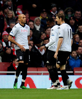 LONDON, ENGLAND - DECEMBER 04:  Diomansy Kamara (L) of Fulham celebrates scoring the equalising goal during the Barclays Premier League match between Arsenal and Fulham at the Emirates Stadium on December 4, 2010 in London, England.  (Photo by Mike Hewitt