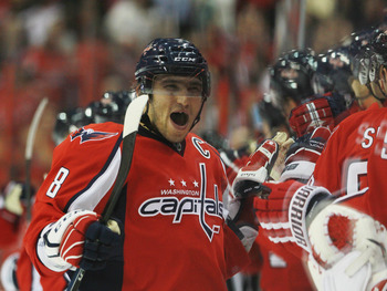 WASHINGTON - OCTOBER 13: Alex Ovechkin #8 of the Washington Capitals celebrates Nicklas Backstrom's game winning goal against the New York Islanders at the Verizon Center on October 13, 2010 in Washington, DC. The Capitals defeated the Islanders 2-1. (Pho