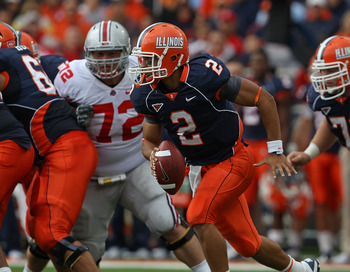 CHAMPAIGN, IL - OCTOBER 02: Nathan Scheelhaase #2 of the Illinois Fighting Illini runs against the Ohio State Buckeyes as Dexter Larimore #72 pursues at Memorial Stadium on October 2, 2010 in Champaign, Illinois. Ohio State defeated Illinois 24-13. (Photo