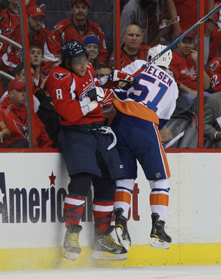 WASHINGTON - OCTOBER 13:  Alex Ovechkin #8 of the Washington Capitals is hit byFrans Nielsen #51 of the New York Islanders at the Verizon Center on October 13, 2010 in Washington, DC.  (Photo by Bruce Bennett/Getty Images)