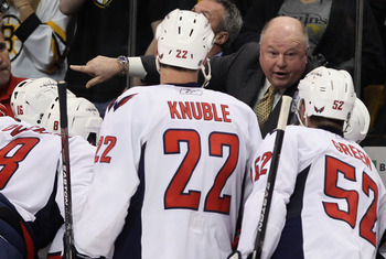 BOSTON, MA - DECEMBER 18:  Head coach Bruce Boudreau of the Washington Capitals talks with his players on the bench in the third period against the Boston Bruins on December 18, 2010 at the TD Garden in Boston, Massachusetts. The Bruins defeated the Capit