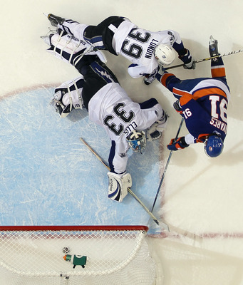 UNIONDALE, NY - DECEMBER 22:  John Tavares #91 of the New York Islanders scores the winning goal in overtime against Dan Ellis #33 of the Tampa Bay Lightning at the Nassau Coliseum on December 22, 2010 in Uniondale, New York. (Photo by Bruce Bennett/Getty